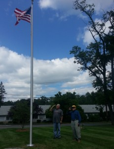 Ed Garcia and Bob Greenhalgh salute the flag on Flag Day, 2014. Our flagpole has just been replaced after being toppled during a winter storm.